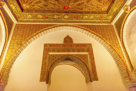 ambassador:  Arch Mosaic Wall Ceiling Ambassador Room Alcazar Royal Palace Seville Andalusia Spain   Originally a Moorish Fort, oldest Royal Palace still in use in Europe  Built in the 1100s and rebuilt in the 1300s   Editorial