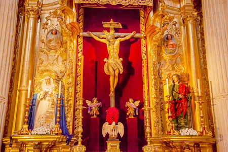 martinez: Jesus Christ Crucifixion on Cross Mary 1600s Wooden Statues by Martinez Montanes in Church of El Salvador, Iglesia de El Salvador, Seville, Andalusia Spain