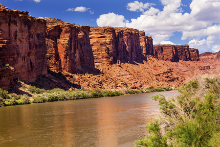 Colorado River Reflection Green Grass Red Rock Canyon Outside Arches National Park Moab Utah USA Southwest
