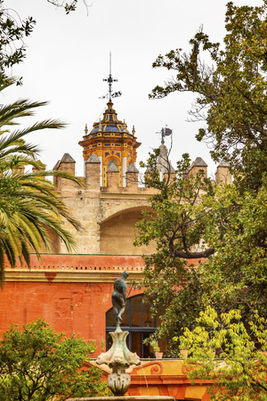 steeples: Church Steeples Statue Garden Alcazar Royal Palace Seville Andalusia Spain   Originally a Moorish Fort, oldest Royal Palace still in use in Europe  Built in the 1100s and rebuilt in the 1300s   Editorial