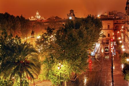 el: Plaza Nueva Ferdinand Statue Train Rainy Night Church El Salvador Seville Andalusia Spain