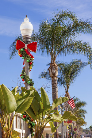 Christmas Lantern Street Light Decorations Banana Trees, Palm Trees, Holiday Time Ventura California  photo