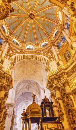 fount: Basilica Dome Stained Glass Baptisim Fount Cathedral Andalusia Grandada Spain   Built in the 1500s, housing the tombs of King Ferdinand and Isabella   Dome by Diego de Siloe, 16th Century Stained Glass by Juan del Campo  Editorial
