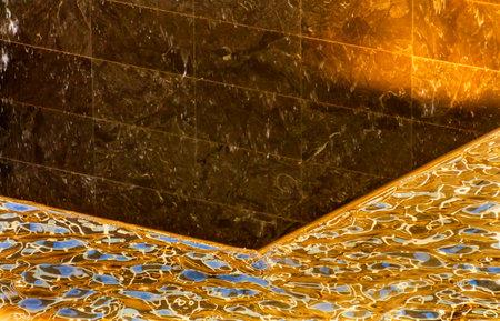 buildings on water: 911 Memorial de piscina de la fuente Cascada Reflexiones Abstract Nueva York NY. La piscina est� en la base de uno de los dos edificios del World Trade Center. El agua cae en el agujero de la base.