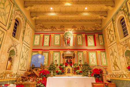 chastity: Old Mission Santa Ines Basilica Altar Cross Agnes Statue Solvang California at Christmas.  Founded in 1804, 19 of 21 Missions in California.  Named for Saint Agnes, young Roman girl martyr, symbol of purity and chastity.