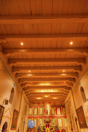 chastity: Old Mission Santa Ines Basilica Altar Cross Solvang California at Christmas.  Founded in 1804, 19 of 21 Missions in California.  Named for Saint Agnes, young Roman girl martyr, symbol of purity and chastity. Editorial