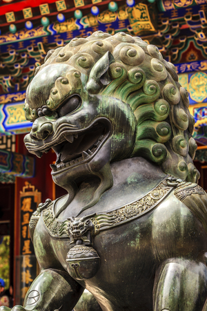 the summer palace: Dragon Bronze Statue Summer Palace Ornate Roof Beijing China Stock Photo