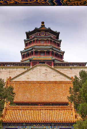 people's cultural palace: Longevity Hill Tower of the Fragrance of the Buddha Orange Roofs Summer Palace Beijing China