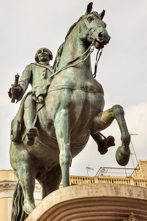 pascal: King Carlos III Equestrian Statue Puerta del Sol Gate of the Sun Most Famous Square in Madrid Spain King of Spain in the 1700s.  Replica of statue created in 1700s by Juan Pascal de de Mena Editorial