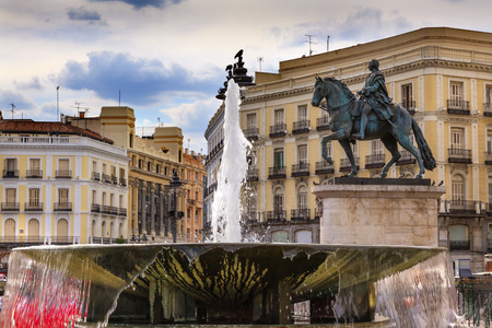 pascal: Puerta del Sol Gate of the Sun Most Famous Square Fountain King Carlos III Equestrian Statue in Madrid Spain King of Spain in the 1700s.  Replica of statue created in 1700s by Juan Pascal de de Mena