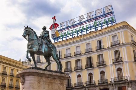 pascal: King Carlos III Equestrian Statue Famous Tio Pepe Sign Puerta del Sol Gate of the Sun Most Famous Square in Madrid Spain King of Spain in the 1700s.  Replica of statue created in 1700s by Juan Pascal de de Mena