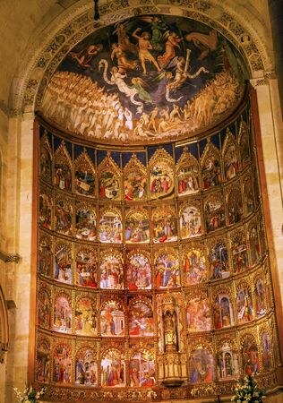 the next life: Ancient Apse House Old Salamanca Cathedral Castile Spain. 52 tablets completed in 1400s, 12 of which by Diego Delli, Italian artist, celebrating life of Jesus and Mary with fresco of final judgment above them.  Old Salamanca Cathedral next to the new Sala