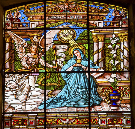 angel gabriel: Annuciation Angel Gabriel Tells Mary She Will Give Birth to Jesus Stained Glass Old Basilica Guadalupe Mexico City Mexico. Also known as Templo Expiatorio a Cristo Rey.  Basilica construction was started in 1531, finished in 1709.  This basilica is the lo