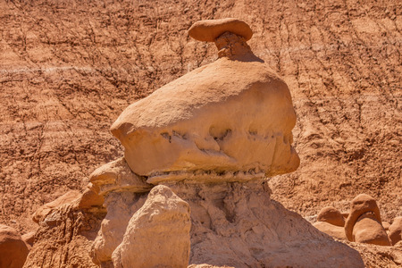 appears: Mushroom Shaped Hoodoo with Chimney Goblin Valley State Park Rock Canyon San Rafael Desert Utah USA Southwest.  Rock hoodoo which appears lik mushroom shaped l goblin. Sandstone on top erosion resistant rock.  Goblins look like modern art statues.