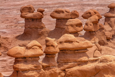 goblins: Watchers Mushroom Shaped Hoodoos Goblin Valley State Park Rock Canyon San Rafael Desert Utah USA Southwest. Thousands of rock hoodoos mushroom shaped like little goblins and munchkins. Sandstone on top erosion resistant rock.  Goblins look like modern art