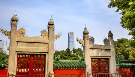 devotions: Red Gate, Temple of Sun City Park, Modern Skyscraper Beijing, China Green Trees Entrance to the Oldest Part of the Temple of the Sun where Emperor would do devotions.