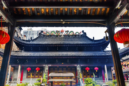song dynasty: Entrance Tianwang Hall Gate Red Lanterns Temple of Six Banyan Tree Buddhist Temple Guangzhou City Guangdong Province China.  Temple built in 537, given its name in the Song Dynasty Red Lanterns Say luck on them. Editorial