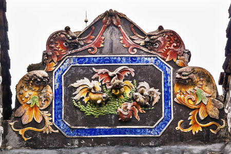 ancestral: Ceramic Carp Fish Figures Statues Dragons Chen Ancestral Taoist Temple Guangzhou City Guangdong Province China.  Most famous Taoist Ancestral temple in Guangzhou City, Guangdong Province, China.  Temple built in the Qing Dynasty in 1894.  Now known as Mus