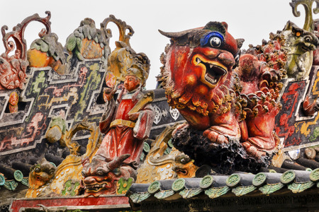 spirtual: Ceramic Figures Statues Dragons Chen Ancestral Taoist Temple Guangzhou City Guangdong Province China.  Most famous Taoist Ancestral temple in Guangzhou City, Guangdong Province, China.  Temple built in the Qing Dynasty in 1894.  Now known as Museum of Fol Editorial