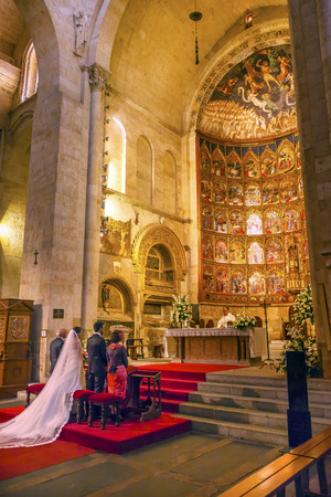 italian fresco: Marriage Groom Bride White Wedding Dress Ancient Apse House Old Salamanca Cathedral Castile Spain. 52 tablets completed in 1400s, 12 of which by Diego Delli, Italian artist, celebrating life of Jesus and Mary with fresco of final judgment above them.  Old Editorial