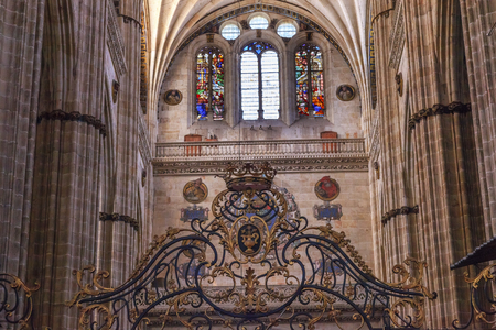 castile: Stone Columns Crest Stained Glass Salamanca New Cathedral Castile Spain. The New and Old Cathedrals in Salamanca are right next to each other.  New Cathedral was built from 1513 to 1733 and commissioned by Ferdinand V of Castile, Spain.
