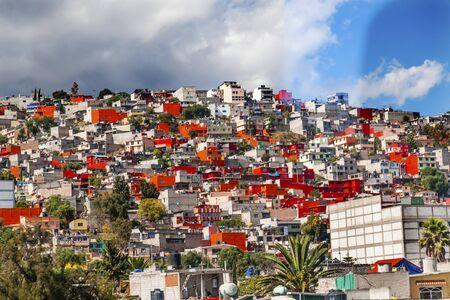 suburbs: Colorful Orange Houses Suburbs, Outskirts Outside Rainstorm Mexico City Mexico  Colorful Orange Houses makes pattern. Stock Photo