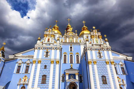 saint michael: Saint Michael Monastery Cathedral Steeples Spires Facade Kiev Ukraine.  Saint Michaels is a functioning Greek Orthordox Monasatery in Kiev.   Stock Photo