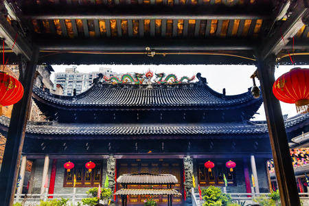 spirtual: Entrance Tianwang Hall Gate Red Lanterns Temple of Six Banyan Tree Buddhist Temple Guangzhou City Guangdong Province China.  Temple built in 537, given its name in the Song Dynasty Red Lanterns Say luck on them. Stock Photo