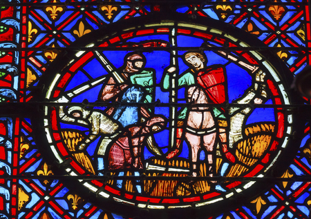 9th: Knights Peasants Field Medieval Life Stained Glass Saint Chapelle Paris France.  Saint King Louis 9th created Sainte Chapelle in 1248 to house Christian relics including Christs Crown of Thorns.  Stained Glass created in the 13th Century and shows variou Editorial