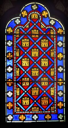 9th: French Monarchy Symbols Fleur de Lile Stained Glass Saint Chapelle Paris France.  Saint King Louis 9th created Sainte Chapelle in 1248 to house Christian relics including Christs Crown of Thorns.  Stained Glass created in the 13th Century and shows vario