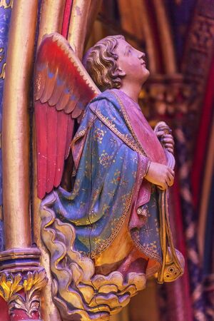 chappel: Angel Wood Carving Cathedral Saint Chapelle Paris France.  Saint King Louis 9th created Sainte Chappel in 1248 to house Christian relics including Christs Crown of Thorns.  Stained Glass created in the 13th Century and shows various biblical stories alon