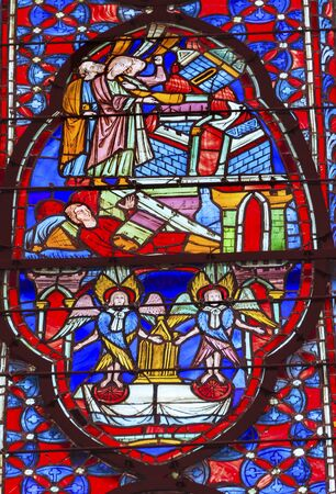 Angels Disciples Stained Glass Saint Chapelle Paris France.  Saint King Louis 9th created Sainte Chappel in 1248 to house Christian relics including Christs Crown of Thorns.  Stained Glass created in the 13th Century and shows various biblical stories al