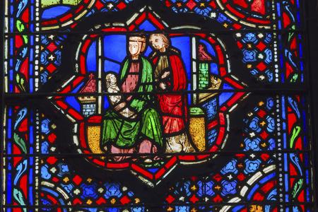 Jesus Mary Joseph Stained Glass Saint Chapelle Paris France.  Saint King Louis 9th created Sainte Chappel in 1248 to house Christian relics including Christs Crown of Thorns.  Stained Glass created in the 13th Century and shows various biblical stories a