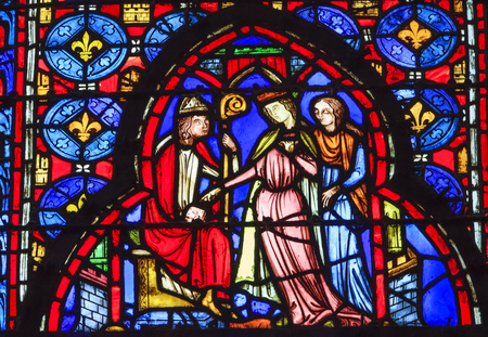 9th: Bishop Queen Stained Glass Saint Chapelle Paris France.  Saint King Louis 9th created Sainte Chappel in 1248 to house Christian relics including Christs Crown of Thorns.  Stained Glass created in the 13th Century and shows various biblical stories along  Editorial