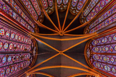 9th: Stained Glass Cathedral Ceiling Saint Chapelle Paris France.  Saint King Louis 9th created Sainte Chappel in 1248 to house Christian relics including Christs Crown of Thorns.  Stained Glass created in the 13th Century and shows various biblical stories a Editorial