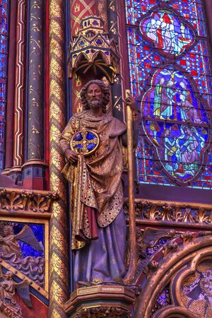 Knight Wood Carving Stained Glass Cathedral Saint Chapelle Paris France.  Saint King Louis 9th created Sainte Chappel in 1248 to house Christian relics including Christs Crown of Thorns.  Stained Glass created in the 13th Century and shows various biblic