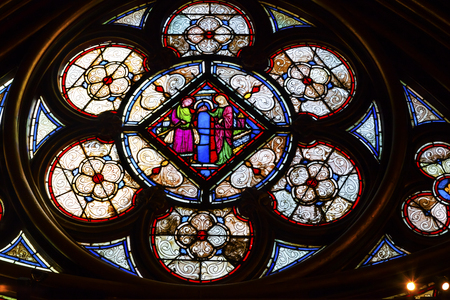 Jesus Mary Stained Glass Lower Chapel Saint Chapelle Paris France.  Saint King Louis 9th created Sainte Chappel in 1248 to house Christian relics including Christs Crown of Thorns.  Stained Glass created in the 13th Century and shows various biblical sto