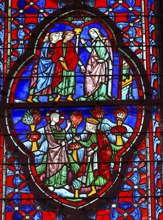 King Christ Mary Stained Glass Saint Chapelle Paris France.  Saint King Louis 9th created Sainte Chappel in 1248 to house Christian relics including Christs Crown of Thorns.  Stained Glass created in the 13th Century and shows various biblical stories al