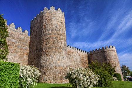 turrets: Walls Turrets Arch Castle Avila Castile Spain.  Described as the most 16th century town in Spain.  Walls created in 1088 after Christians conquer and take the city from the Moors Editorial