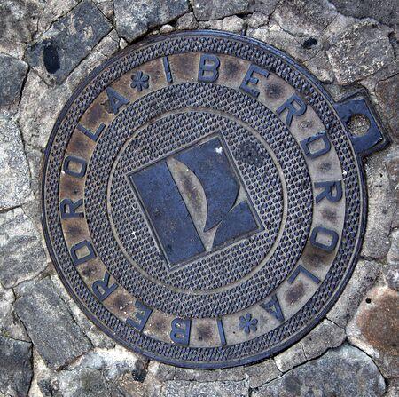 manhole cover: Iberdrola Energy Manhole Cover Avila Castile Spain.  Iberdrola is largest energy group in Spain.
