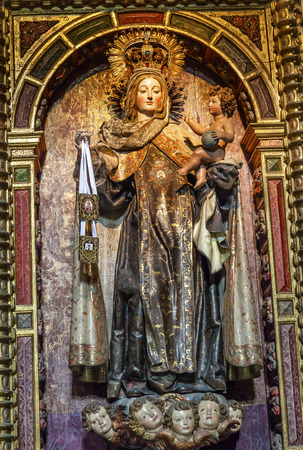 virgin: Virgin Mary Crown Jewels Baby Jesus Angels Wooden Statue San Juan Bautista Church Avila Castile Spain.  Parroquia de San Juan Bautista.  Gothic church built in the 1500s.  Avila is a an ancient walled medieval city in Spain. Editorial
