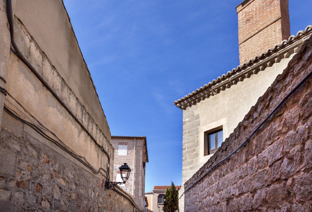 described: Avila Narrow City Streets Castle Walls Swallows Castile Spain.  Avila is described as the most 16th century town in Spain.  Walls created in 1088 after Christians conquer and take the city from the Moors Editorial