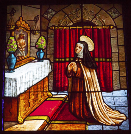 religions: Saint Teresa Praying to Jesus Stained Glass Convento de Santa Teresa Basilica Avila Castile Spain.  Convent founded in 1636 for Saint Teresa, Catholic nun, Counterreformation author, and Spanish mystic, who founded the Carmelite order. Died in 1582 and ma