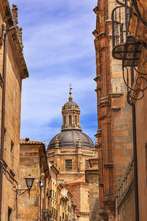 ferdinand: Stone Dome New Salamanca Cathedral Street Spain.   New Cathedral was built from 1513 to 1733 and commissioned by Ferdinand V of Castile, Spain.