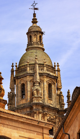 commissioned: Stone Steeple New Salamanca Cathedral Spain.  New Cathedral was built from 1513 to 1733 and commissioned by Ferdinand V of Castile, Spain.