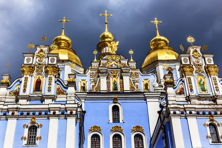 saint michael: Saint Michael Monastery Cathedral Steeples Spires Facade Kiev Ukraine.  Saint Michaels is a functioning Greek Orthordox Monasatery in Kiev.  The original monastery was created in the 1100s but was destroyed by the Soviet Union in the 1930s.  St. Michaels