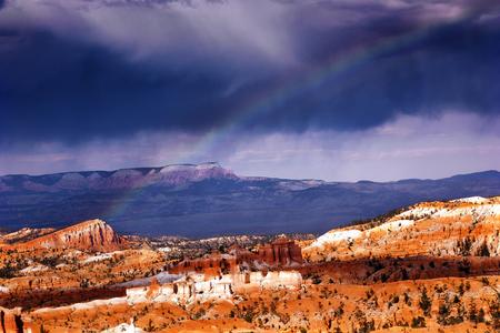 hoodoos: Rainbow Dark Clouds Storm Amphitheater Hoodoos Bryce Point Bryce Canyon National Park Utah Stock Photo