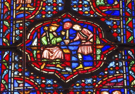 beheading: Knight Presenting Head of Enemy to KIng Louis 9th Stained Glass Saint Chapelle Paris France.  Saint King Louis 9th created Sainte Chapelle in 1248 to house Christian relics, including Christs Crown of Thorns.  Stained Glass created in the 13th Century an