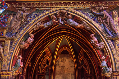 chappel: Angels Wood Carvings Arch Cathedral Saint Chapelle Paris France.  Saint King Louis 9th created Sainte Chappel in 1248 to house Christian relics, including Christs Crown of Thorns.  Stained Glass created in the 13th Century and shows various biblical stor