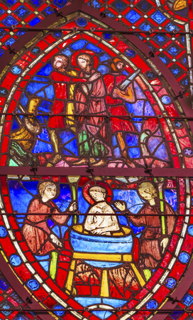9th: Knights Peasants Attempt to Boil Saint John In Oil Stained Glass Saint Chapelle Paris France.  Saint King Louis 9th created Sainte Chappel in 1248 to house Christian relics, including Christs Crown of Thorns.  Stained Glass created in the 13th Century an Editorial
